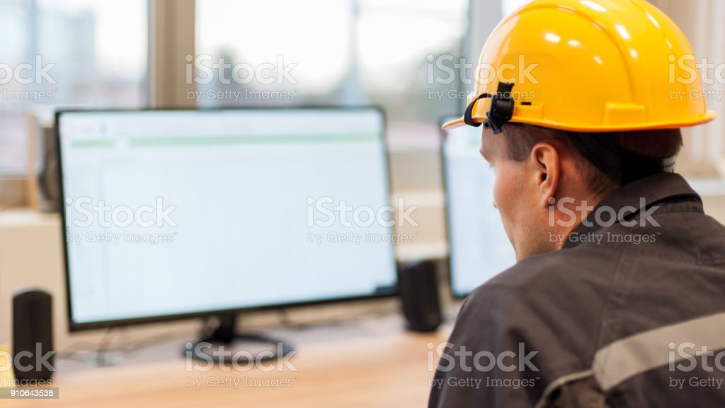 Maintenance engineer inspect relay protection system from control computer center stock photo