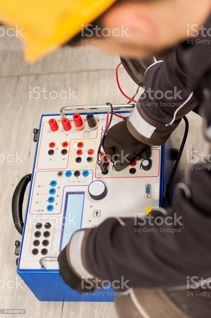 Maintenance engineer inspect system with relay test set equipment stock photo