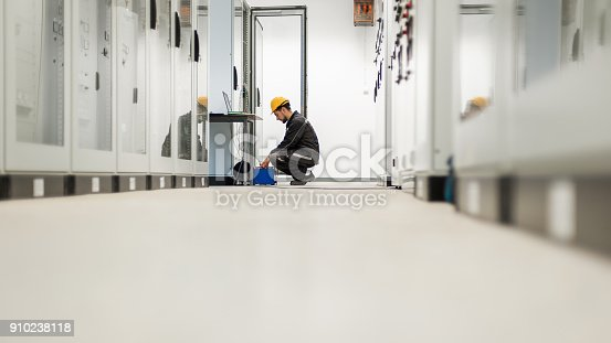 istock Maintenance engineer inspect system with relay test set equipment 910238118