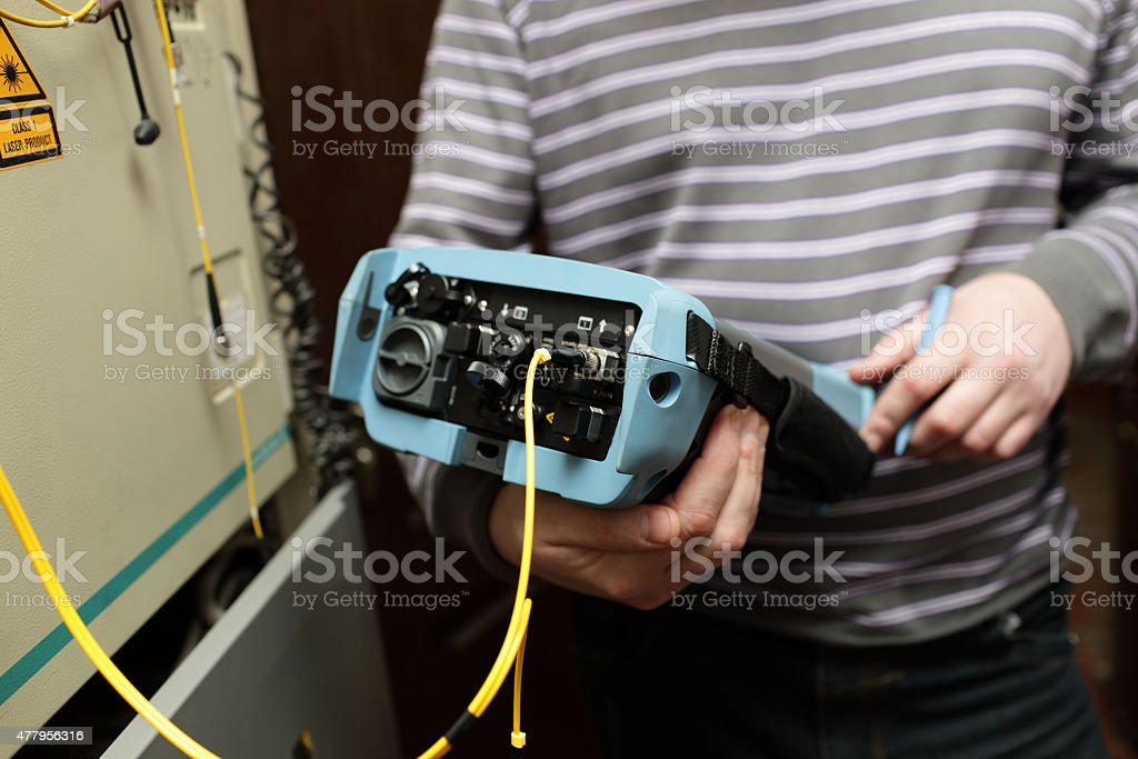 Maintenance engineer with reflectometer stock photo