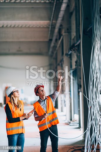 Maintenance Engineers checking electricity