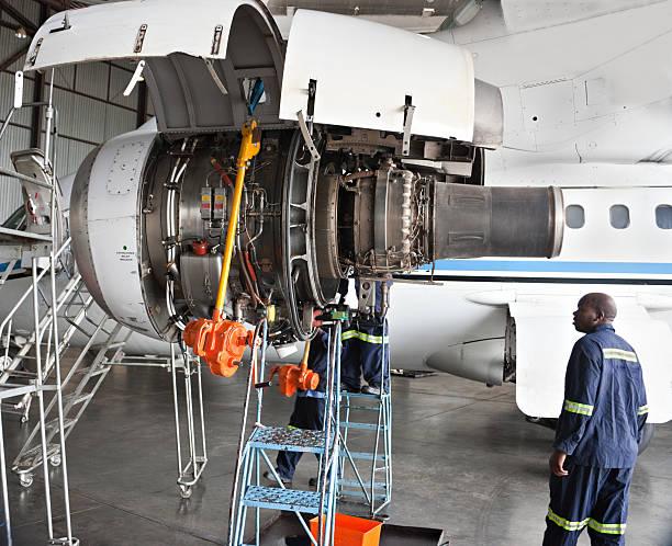 Maintenance men working on an aircraft stock photo
