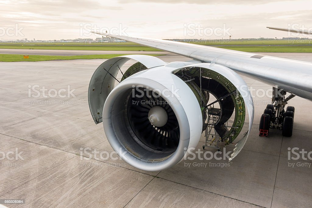 Maintenance of engine in an airplane stock photo