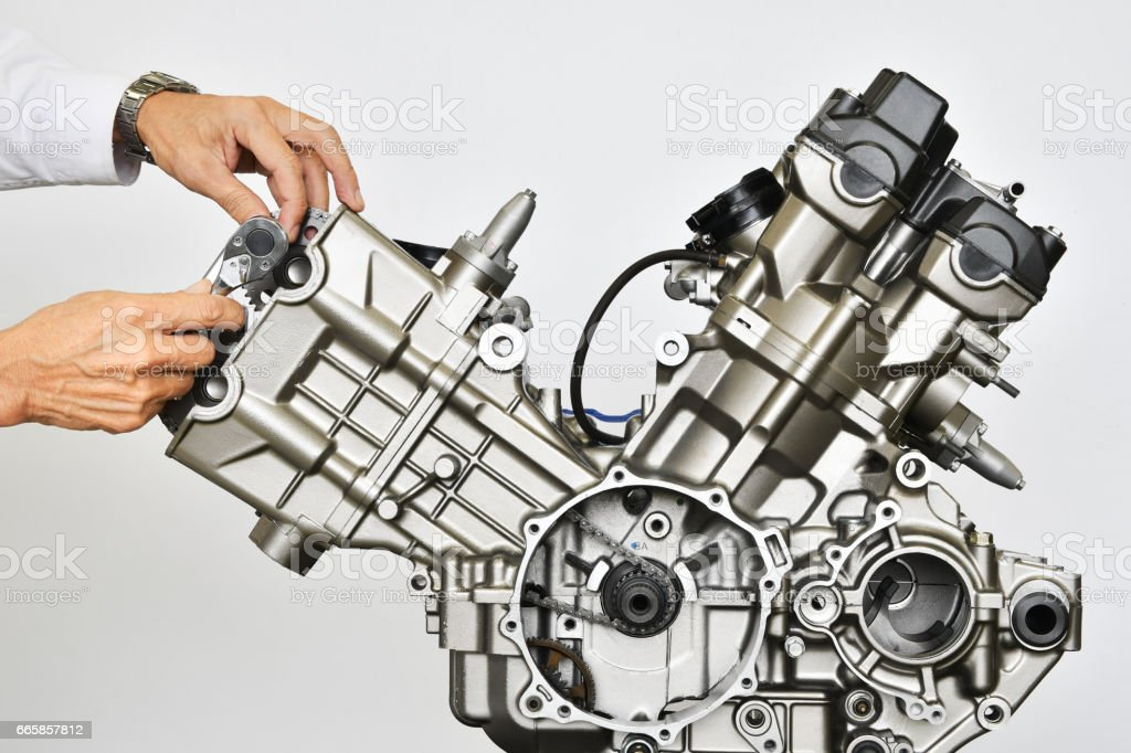 Maintenance of motorcycle engine stock photo