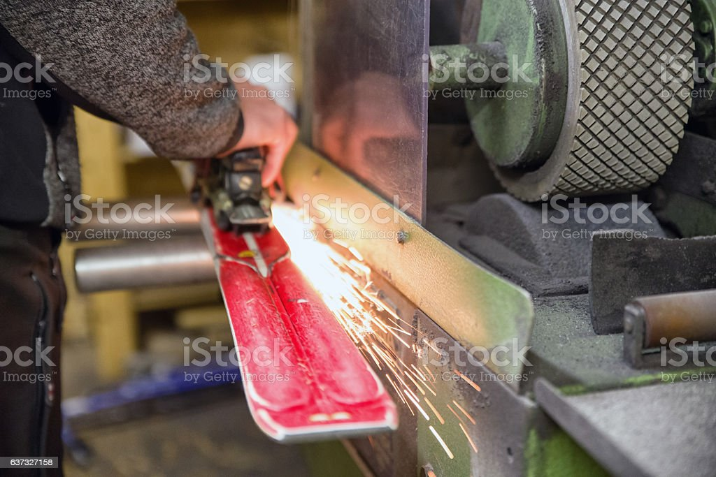 Maintenance of skis stock photo