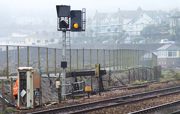 maintenance on railway electrical signalling equipment - railway signal stock photos and pictures