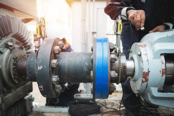 Maintenance Technician inspector alignment pump  and electric motor, Repairing work in factory concept coupling device stock pictures, royalty-free photos & images