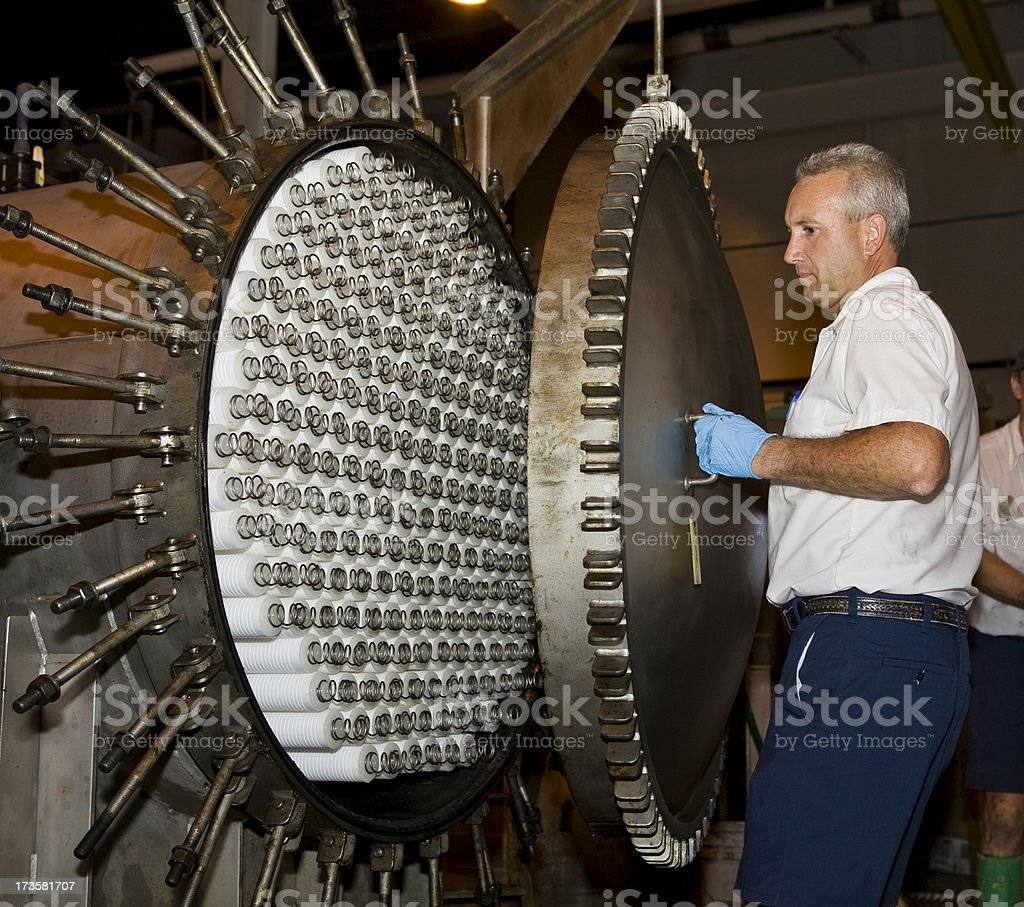 Maintenance Technician Closing Filtering Tank at a Water Purification Plant royalty-free stock photo