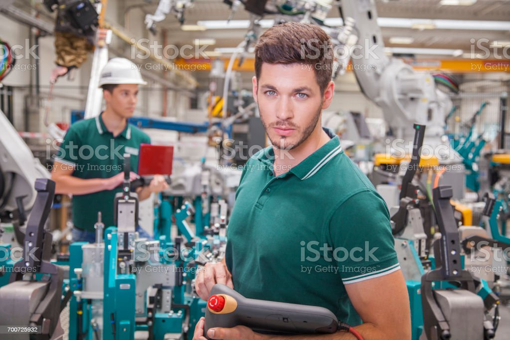maintenance technicians team while programming robots stock photo