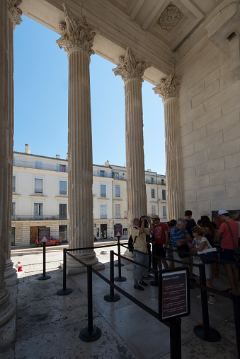 Tourists visiting the Maison Carrée. The Maison Carrée (French for