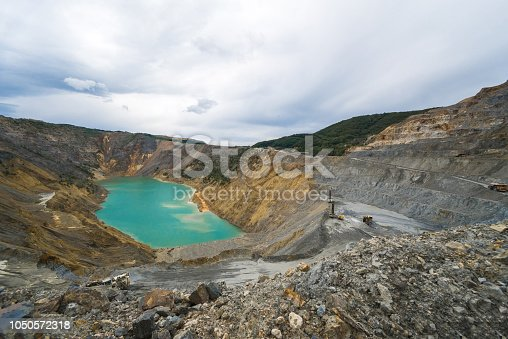 Wide angle view of an open surface mining copper mine on an overcast day. Shot in Majdanpek, Serbia, May 2016.