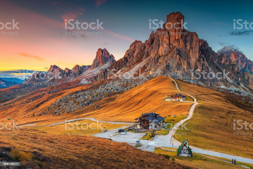 Majestic alpine pass with high peaks in background, Dolomites, Italy stock photo