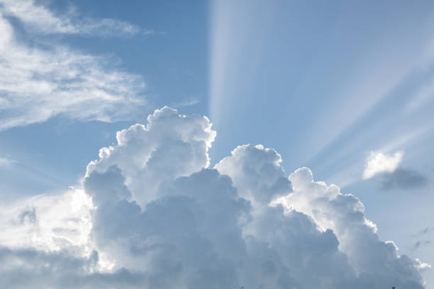 Majestic Billowy Cumulus Mountains with Sun Beams stock photo