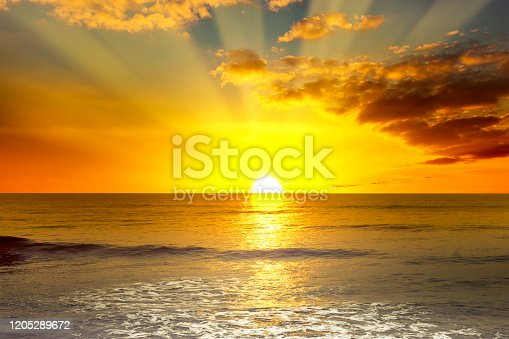 istock Majestic bright sunrise over ocean 1205289672