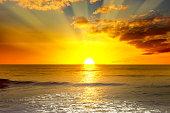 istock Majestic bright sunrise over ocean 1205289672