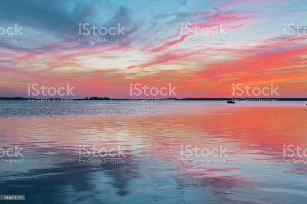Majestic cloudscape at dusk with reflection on lake stock photo