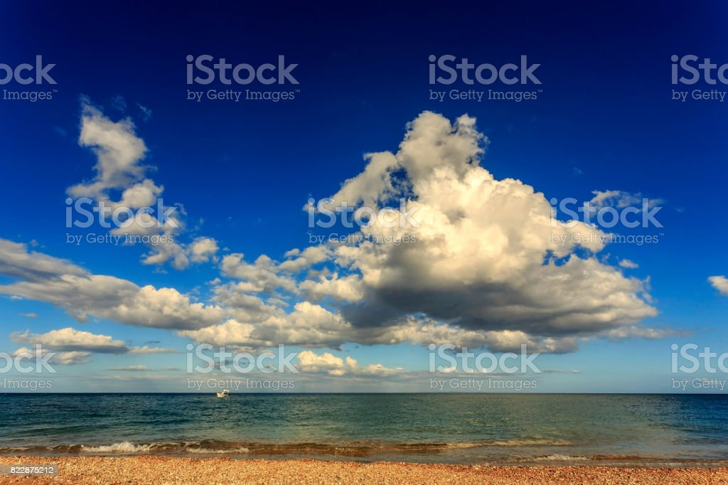 Majestic cumulus cloud above the Ionian Sea at Skala beach in Kefalonia stock photo