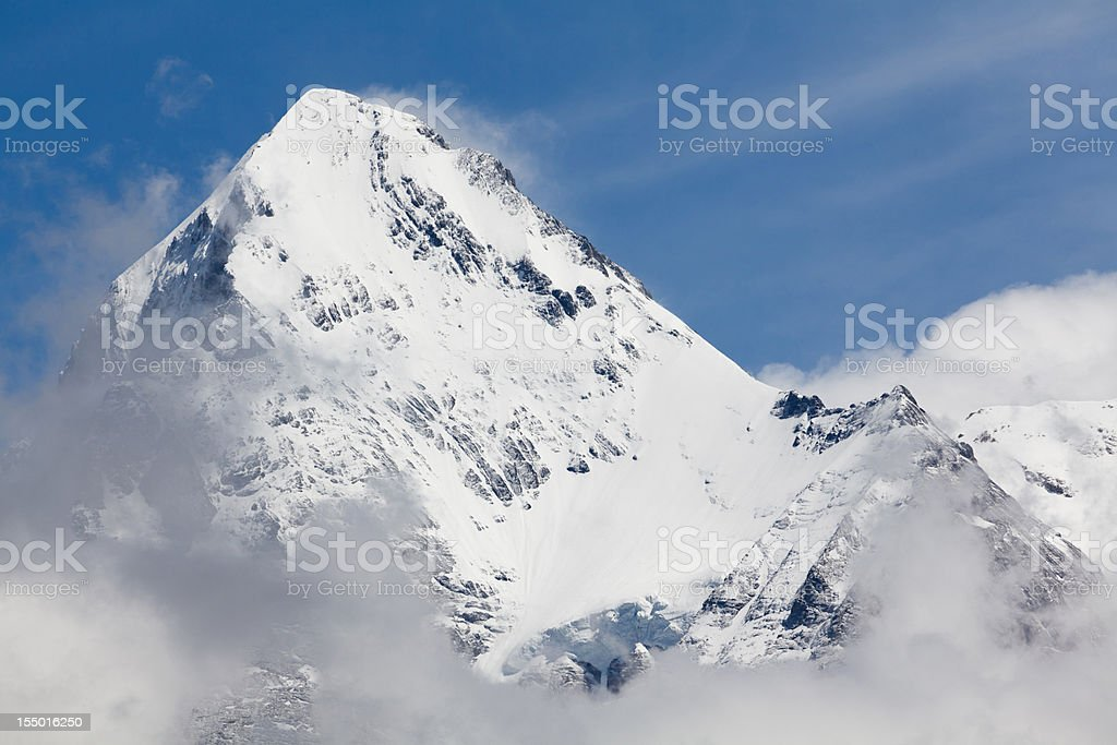 Majestic Eiger Peak above the Clouds, Bernese Alps, Switzerland royalty-free stock photo