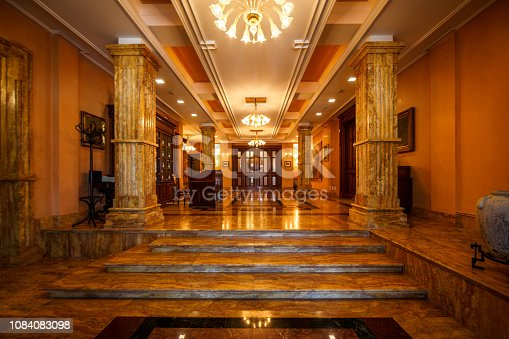 istock Majestic entrance with steps and marble pillars 1084083098