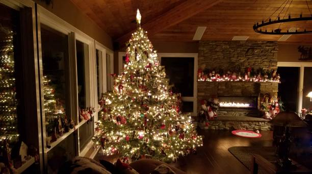 Majestic Holiday Christmas Tree in a Large Log Cabin Rustic Setting stock photo