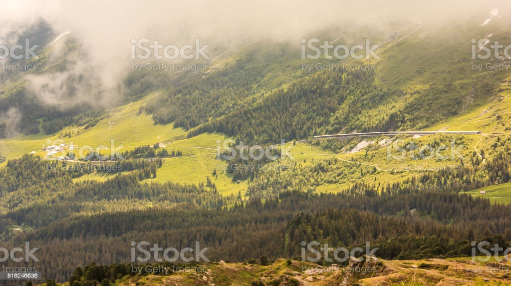 Majestic Mannlichen-Kleine Scheidegg Trail with breathtaking panoramic view of beautiful swiss alps, forest, mountain pass landscape on a mysterious foggy day, Bern Canton, Switzerland, Europe. Mannlichen can be reached from Wengen or Grindelwald cableway stock photo