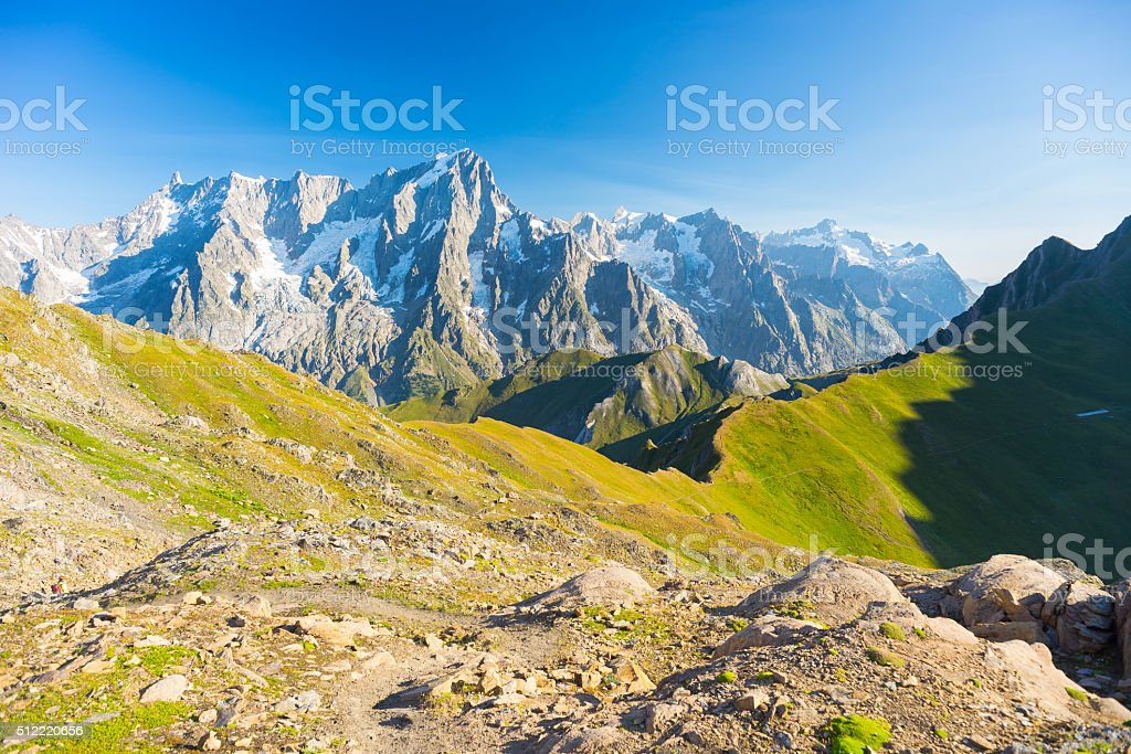 Majestic Mont Blanc massif and lush green alpine valley stock photo