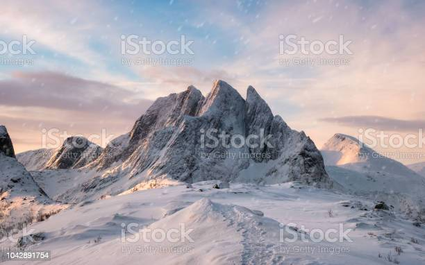 Photo of Majestic mountain range with snowfall at sunrise morning