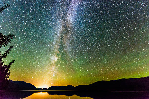majestic night sky illuminated with stars and milky way landscape - mcdonald lake stock pictures, royalty-free photos & images