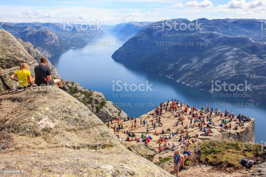 Majestic Panoramic summer view of the world famous Preikestolen (Preacher's Pulpit or Pulpit Rock), Forsand, Rogaland, Stavanger, Norway. Stunning and picturesque Lysefjord and nature as a background. stock photo