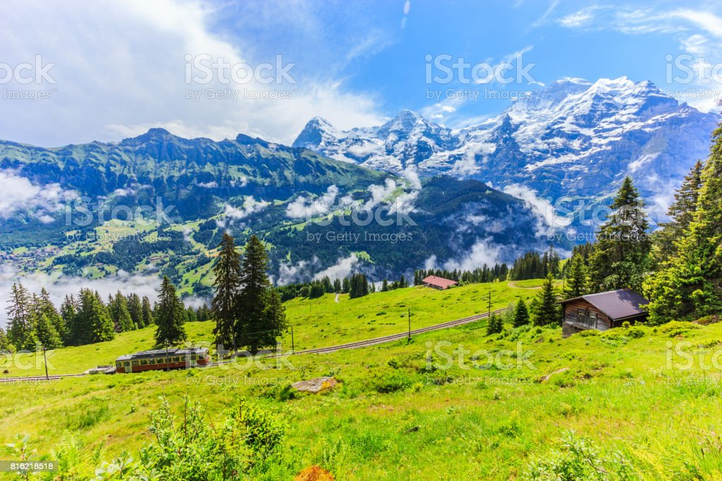 Majestic panoramic view of Eiger, Monch, Jungfrau mountains from Murren-Gimmelwald trail, Swiss alps, Bernese Oberland, Berne Canton, Switzerland, Europe. Great outdoor trail ,best scenery for family activities, start from Lauterbrunnen station. stock photo