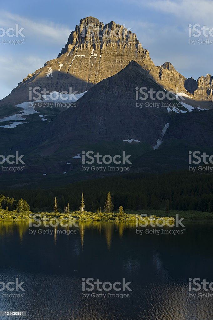 Majestic Peaks and Lake Reflection in Glacier National Park Montana royalty-free stock photo