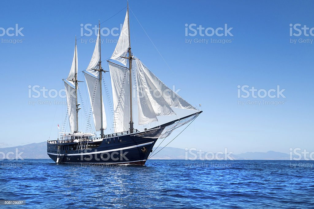Majestic sailboat in the Indo-Pacific Ocean in Indonesia stock photo