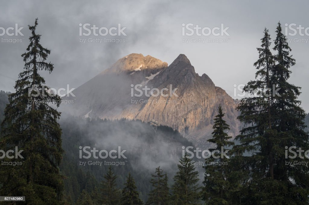 Majestic scenery of rocky mountains at golden sunset in Dolomites National Park stock photo