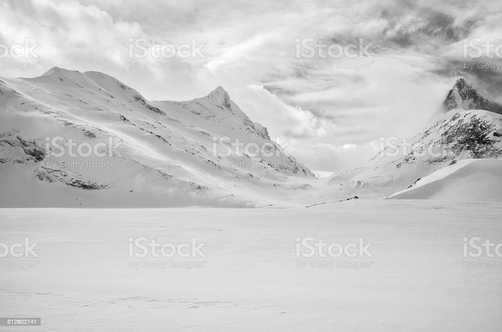 Majestic snow covered mountain peaks in Jotunheimen National Park stock photo