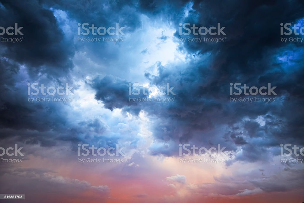 Majestic Storm Clouds Beautiful storm clouds on a summer night with pinks and blues. Backgrounds Stock Photo