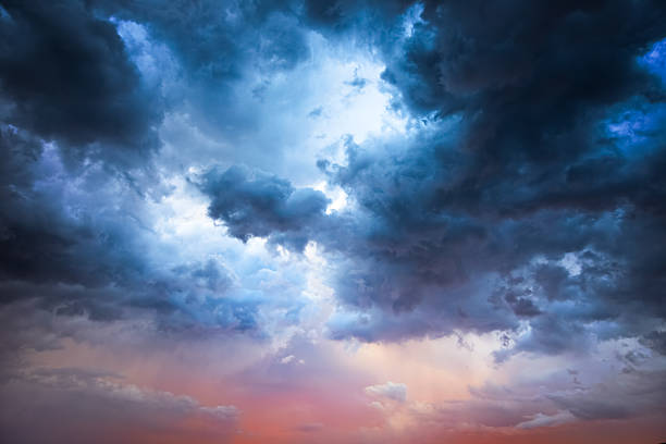 majestic storm clouds - dramatic sky stock photos and pictures