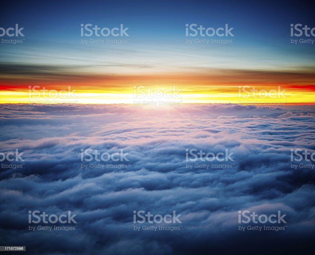 majestic sunrise above clouds stock photo
