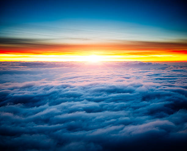 sunrise with clouds over water above clouds pictures images and stock photos istock