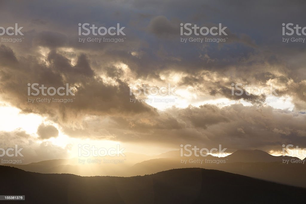 majestic sunrise in the mountains with clouds royalty-free stock photo