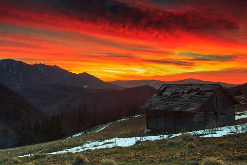 Ramshackle hut and beautiful sunrise in the mountains,Ciucas,Transylvania,Romania