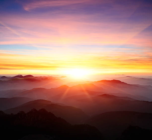 majestic sunrise over the mountains - dramatic sky stock photos and pictures