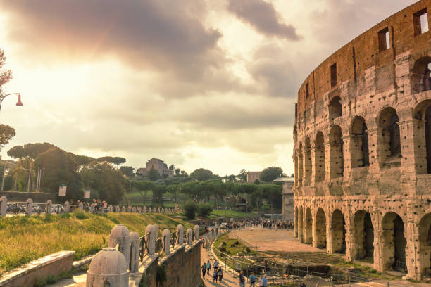 Majestic sunset at the Colosseum with Palatine Hills in Rome Majestic sunset at the Colosseum with Palatine Hills in Rome palatine hill rome stock pictures, royalty-free photos & images