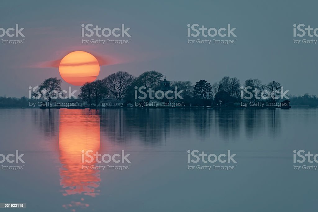 Majestic Sunset over Island in Lake stock photo