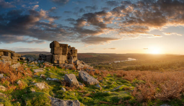 Majestic sunset over landscape of Leather Tor in Dartmoor during Summer with dramatic sky stock photo