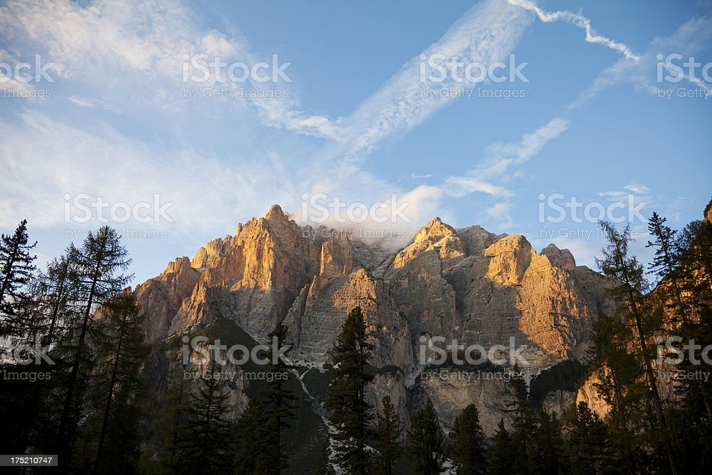 majestic sunset over the Dolomite mountains stock photo