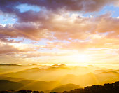 majestic sunset over misty mountains+++image composite+++