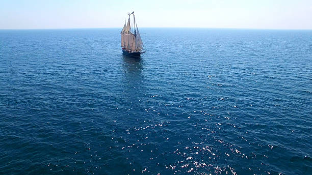 Majestic tall ship alone on a vast blue sea Majestic tall ship all alone on a vast blue sea. pilgrim stock pictures, royalty-free photos & images