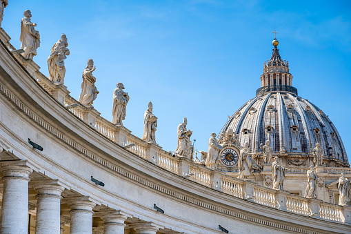 A majestic view of Bernini's colonnade in the square of St. Peter's Basilica in Rome