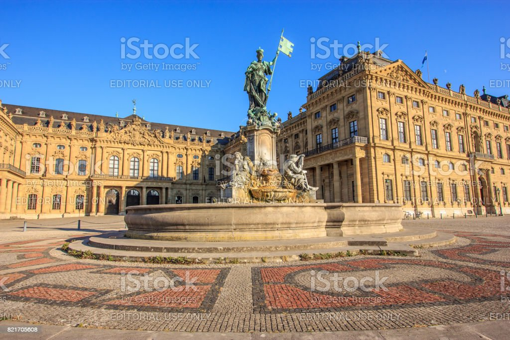 Majestic view of Frankonia fountain and facade of the Wurzburg Residence in Wurzburg, Bavaria, Germany , Europe. stock photo