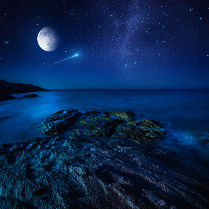 Majestic view of sea and moon at night
